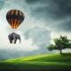 """Billede af en elefant, der bliver fløjet over en eng af en luftballon. Blogindlæg med en øvelse til at blive fri til at lukke de positive forandringer ind i dit liv og samtidigt slippe dit """"burde""""-offer, der hænger fast i skyldfølelser."""
